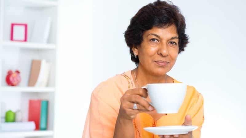 Senior Indian woman drinking green tea