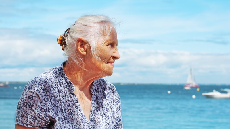 Senior woman is traveling with an aging parent. Or is SHE the aging parent?