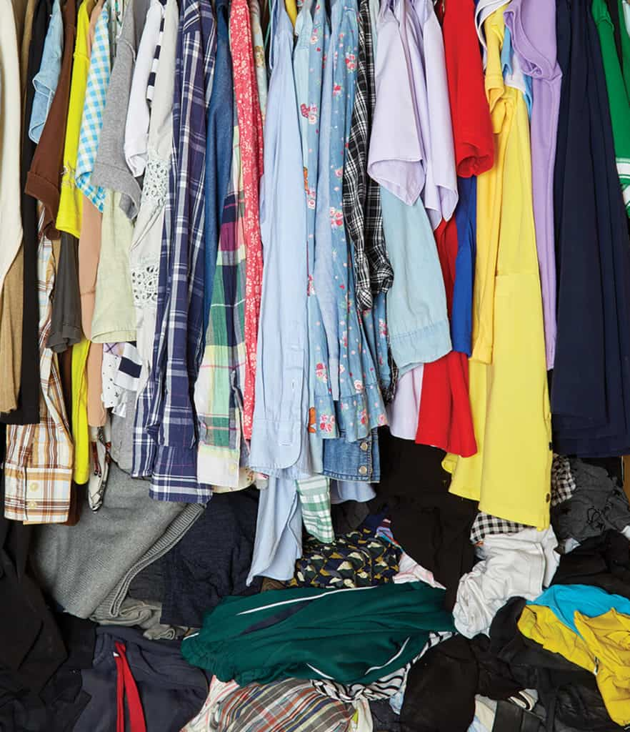 Overflowing closet of a verity of clothing