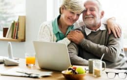 Happy senior man with his wife smiling and hugging