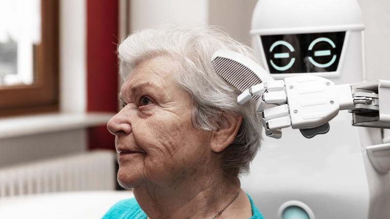 Care-bots brushing a seniors hair