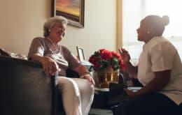 nurse speaking to senior woman