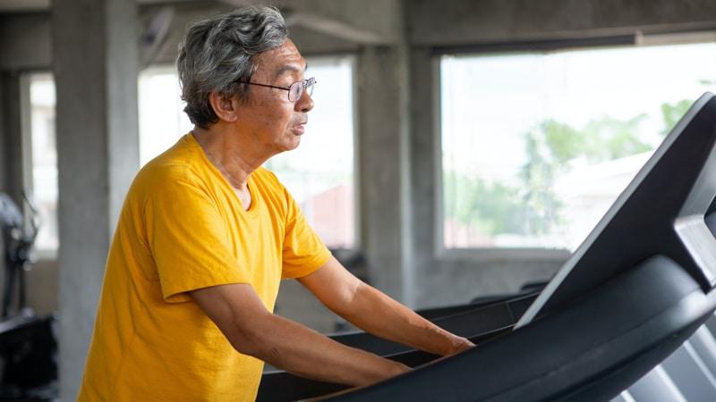 Senior man walking on treadmill for prehabilitation