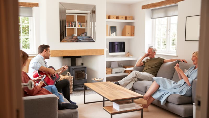 Adult son gives parents a private concert with his guitar while his wife ignores him. Multigenerational living.