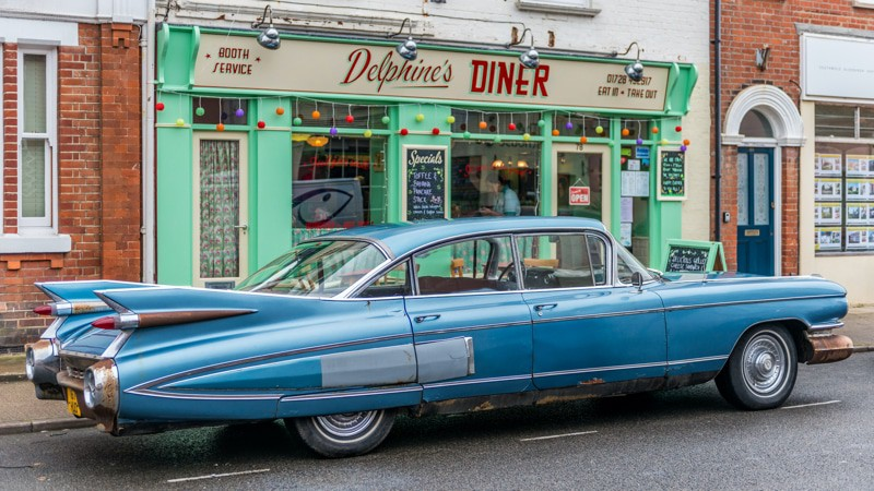 1950s car in front of an old diner