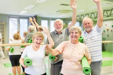 Group of seniors is having fun together in the gym