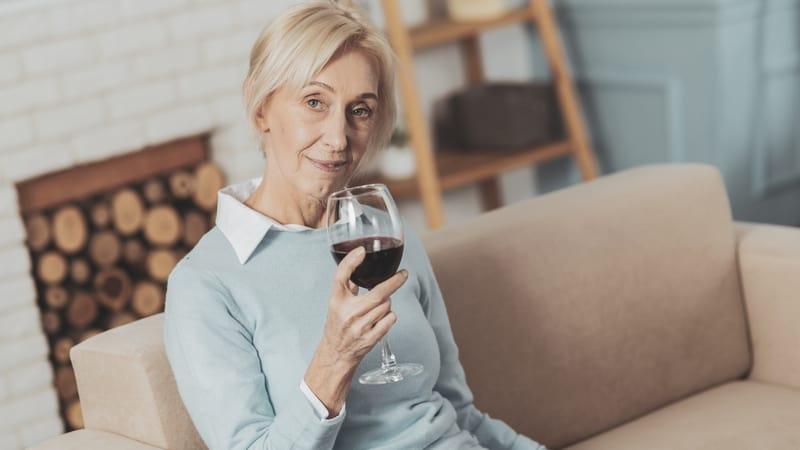 Senior is sitting on her couch binge drinking
