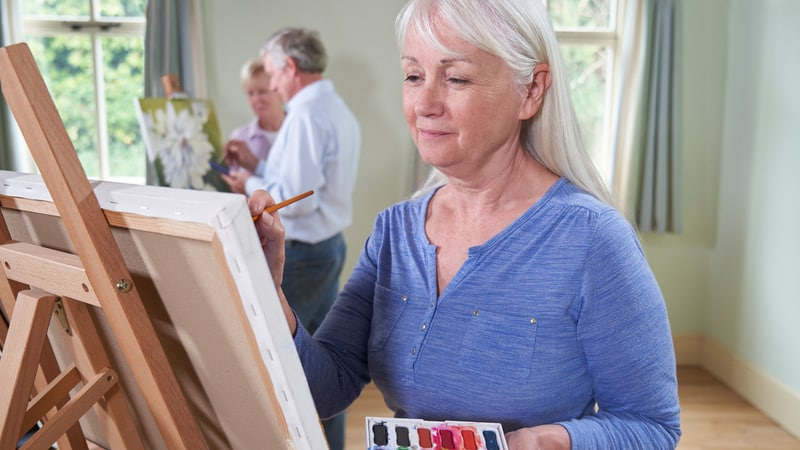 Senior enjoying the benefits of art