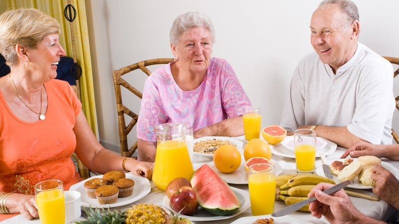 Seniors enjoying brunch and mimosas at their Residential Care Home