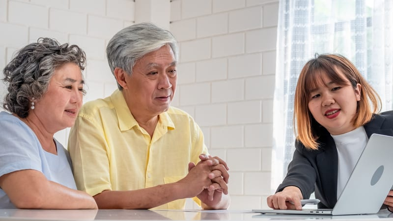 Senior Asian couple looking at retirement communities