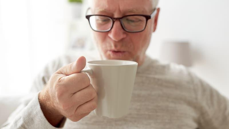 Senior man drinking coffee in his affordable senior living