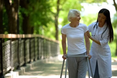 Nurse and patient in skilled nursing care