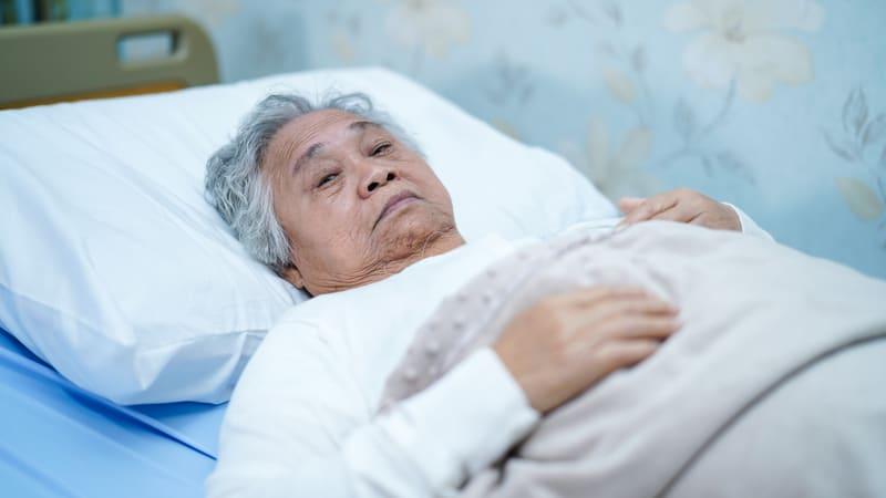 Senior man getting no sleep at the hospital