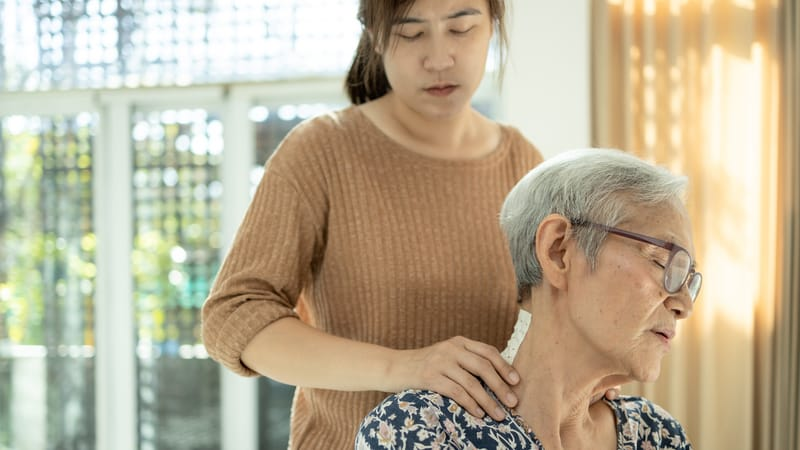 Woman caregiving for her mother