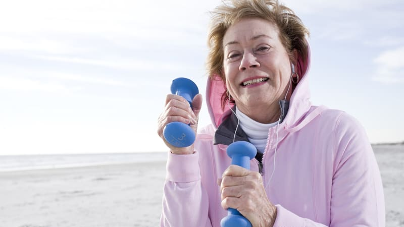 Senior woman lifts weights to prevent age-related muscle loss