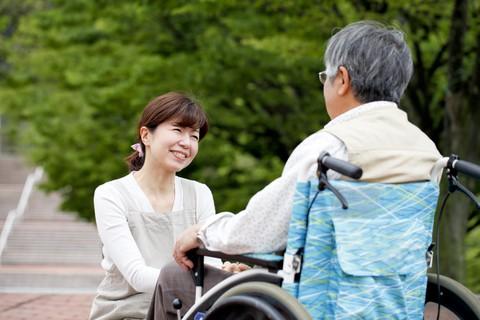 Senior woman in a garden at a memory care center