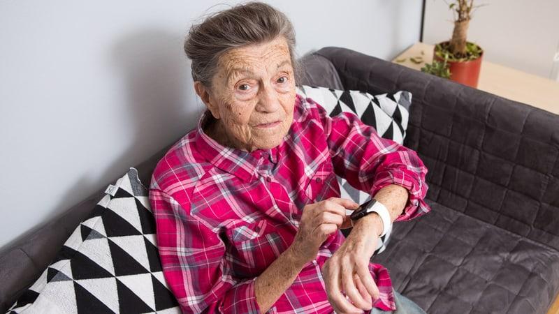 Senior woman wears a GPS tracker for dementia
