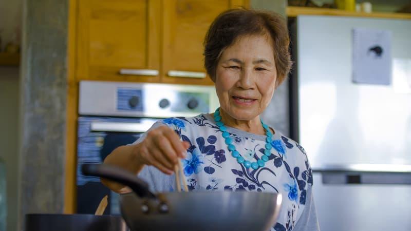 Senior woman cooking recipes for seniors
