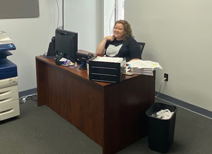 Compass Home Care Employee at Desk