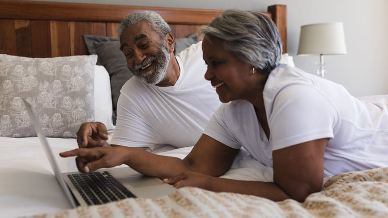Senior couple taking a virtual tour assisted living