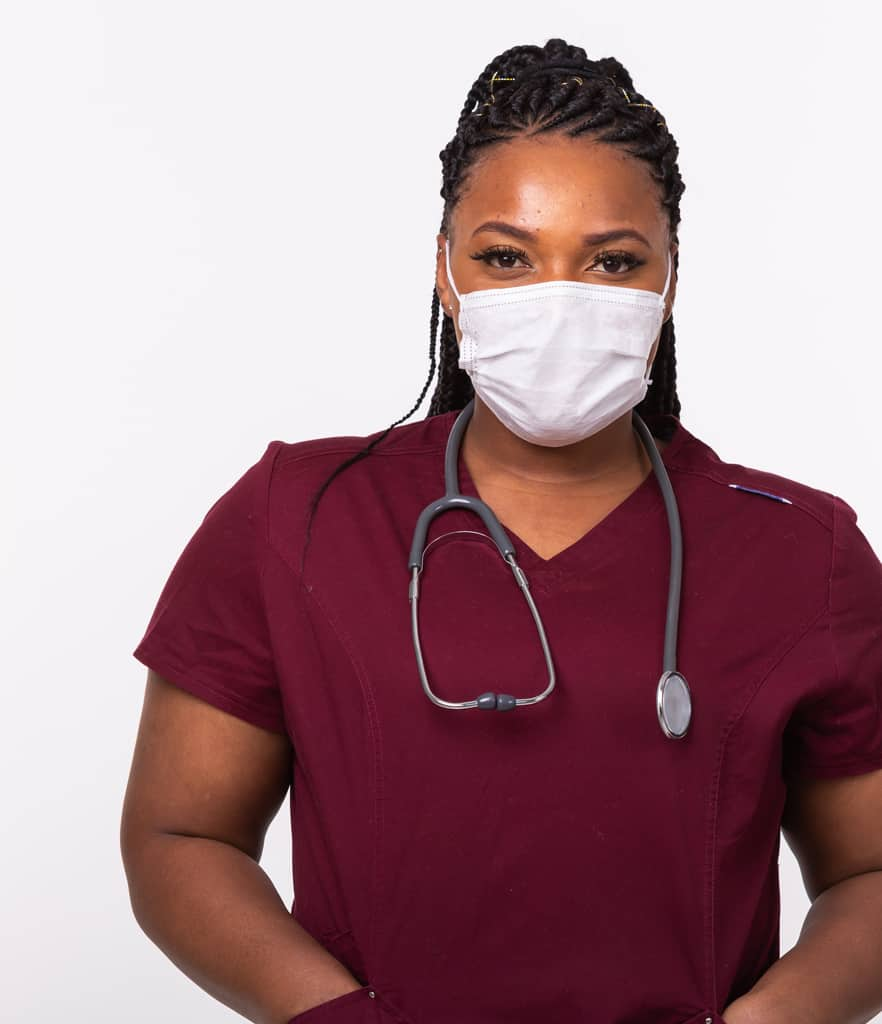 Nurse in red scrubs wearing mask
