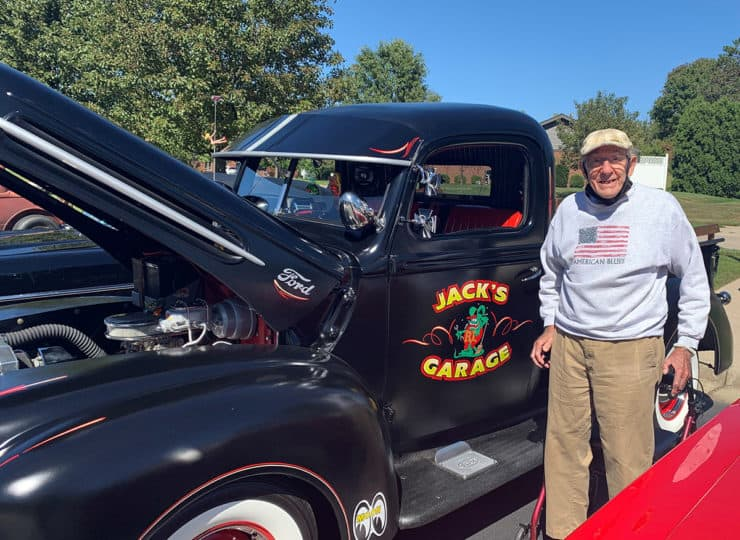 Sycamore Glen Retirement Community Resident Standing Next To Old Truck
