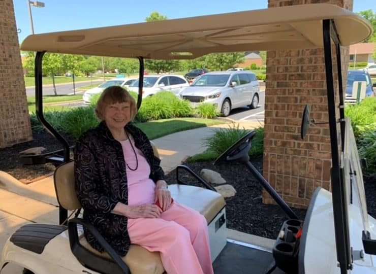 Sycamore Glen Retirement Resident In Golf Cart