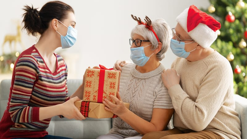 Woman taking COVID precautions around seniors