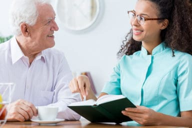 Peace Haven Home Care Services Caregiver Talking with Elderly Man