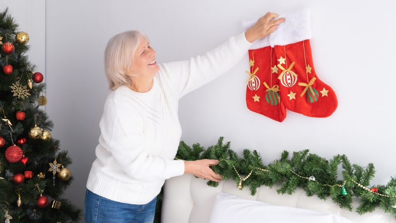 Woman doing some holiday decorating for small senior space