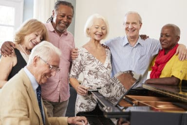 A group enjoying music therapy for seniors