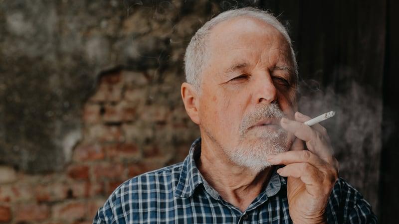 Senior man realizing quitting smoking for seniors is hard