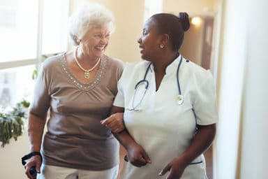 Two woman at a skilled nursing facility or is it a nursing home?