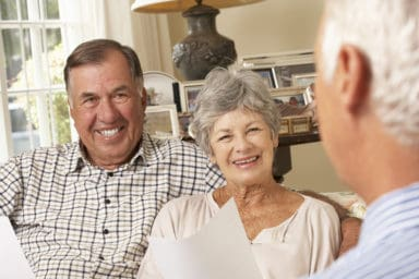 All About Seniors Senior Couple Talking with Senior Man