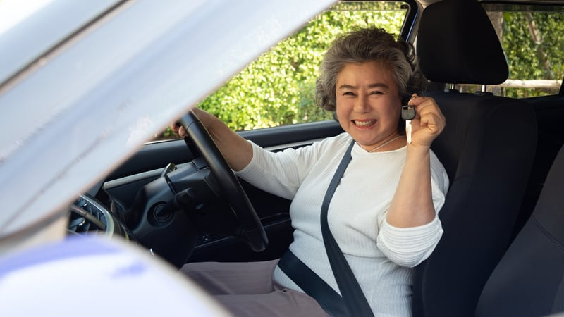 Senior woman buying a car in retirement
