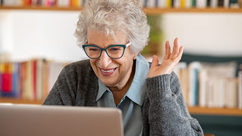 Senior woman getting duped by internet romance scams