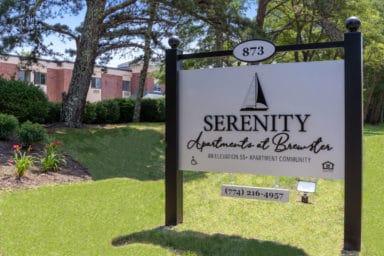 Serenity Apartments at Brewster sign