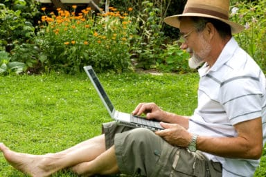 Seniors and technology during COVID occurred a lot, as demonstrated by this man on his laptop in his garden