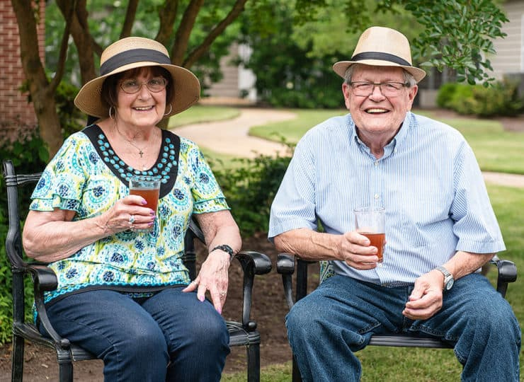 Commonwealth Senior Living Hampton Senior Couple Outdoor Drinking Iced Tea