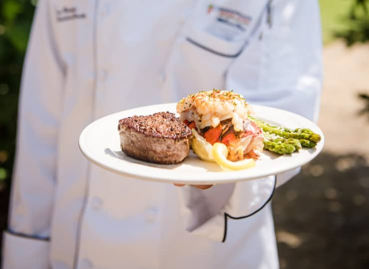 Commonwealth Senior Living Hampton Chef Holding Plates of Food