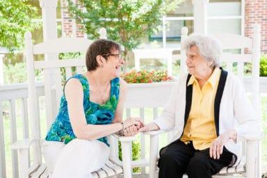 Commonwealth Senior Living Leigh Hall Mom Daughter Laughing Inside Gazebo