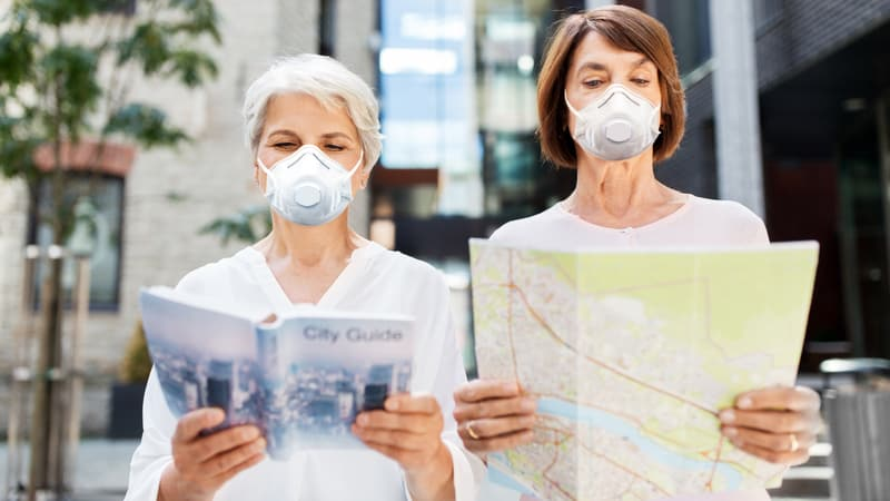 Two women engaging in post-pandemic travel