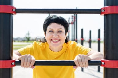 Woman with mullet doing parkour for seniors