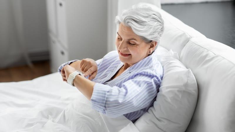 Senior woman using wearable sleep technology