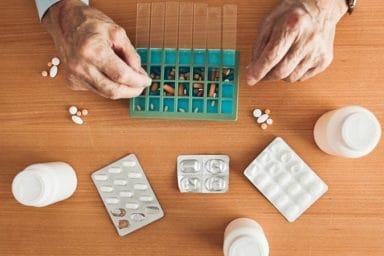 Senior man practicing safe medication management