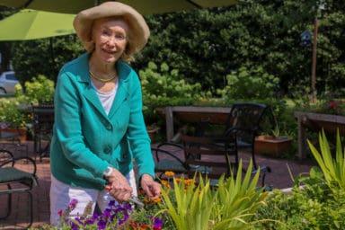 Fran gardening at Hermitage Richmond