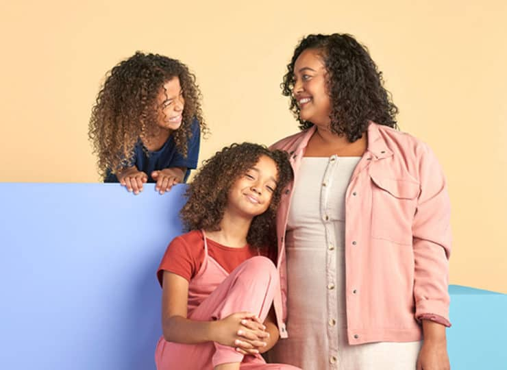 Trust and Will Mother with Two Daughters Smiling