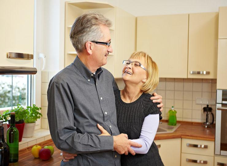 Make It Home Elderly Couple Hugging in Kitchen