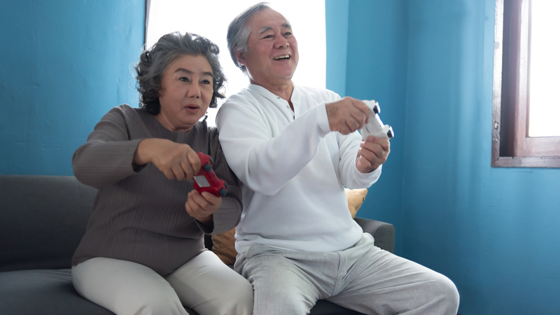 Couple playing some of the best video games for seniors