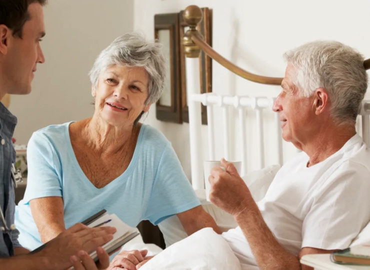 Grace Care Solutions Caregiver with Elderly Couple